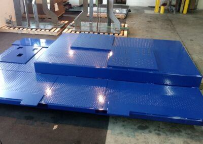 Robot raisers, pedestals and base plates